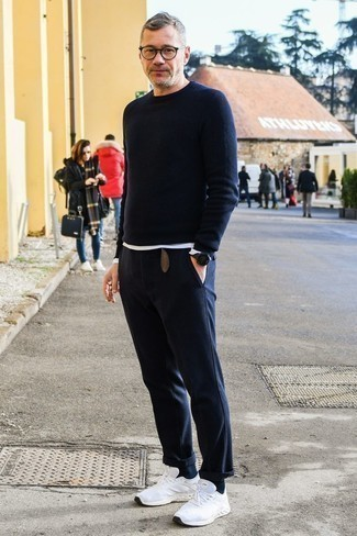 How to Wear Navy Jeans For Men: A navy crew-neck sweater and navy jeans are among the fundamental items in any man's functional casual sartorial collection. Bring a more casual vibe to by finishing with a pair of white athletic shoes.