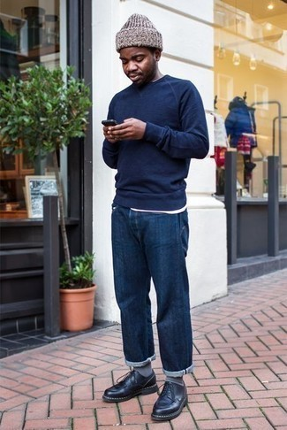 Men's Looks & Outfits: What To Wear In Spring: This casual combo of a navy crew-neck sweater and navy jeans is a goofproof option when you need to look nice in a flash. For footwear, you could follow a more elegant route with black leather derby shoes. So if you're hunting for an ensemble that's dapper but also totally spring-appropriate, this just might be it.