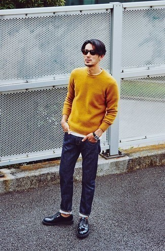 Mustard Crew-neck Sweater Outfits For Men: For an off-duty ensemble, consider teaming a mustard crew-neck sweater with navy jeans — these pieces fit really well together. Introduce a pair of navy leather derby shoes to the equation to instantly shake up the look.