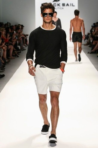 Rock a black crew-neck sweater with white shorts to get a laid-back yet stylish look. Complement this look with slip-on sneakers.