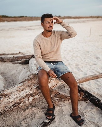 Beige Crew-neck Sweater Relaxed Outfits For Men: This contemporary combination of a beige crew-neck sweater and blue ripped denim shorts is very easy to throw together in no time flat, helping you look awesome and ready for anything without spending a ton of time combing through your wardrobe. Black leather sandals are guaranteed to bring an air of stylish casualness to this getup.