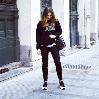 Dress in a black and white print crew-neck sweater and black skinny jeans for a comfortable outfit that's also put together nicely. Black and white trainers will add some edge to an otherwise classic look.