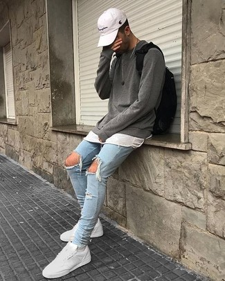 How to wear: grey crew-neck sweater, white crew-neck t-shirt, light blue ripped skinny jeans, white leather low top sneakers