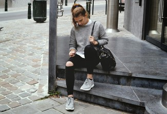 This combo of a grey crew-neck jumper and black ripped skinny jeans will attract attention for all the right reasons. Grey trainers will give your look an on-trend feel.