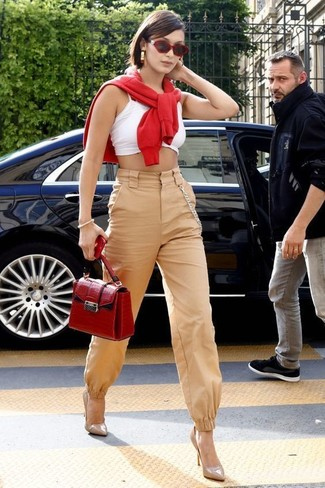 A Derek Lam Knit Crew Neck Sweater and tan tapered pants are both versatile essentials that will give your outfits a subtle modification. And it's a wonder what a pair of beige leather pumps can do for the look. So if you're on a mission for an insta-worthy outfit on a hot weather day, this just might be it.