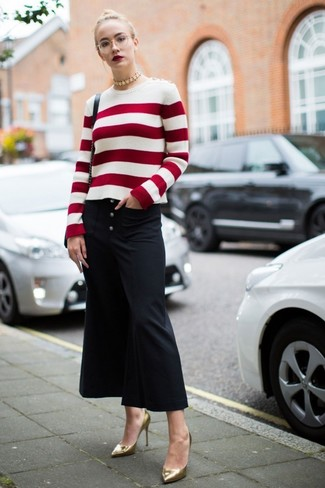 The versatility of a white and red horizontal striped crew-neck sweater and black culottes makes them investment-worthy pieces. Polish off the ensemble with gold leather pumps.