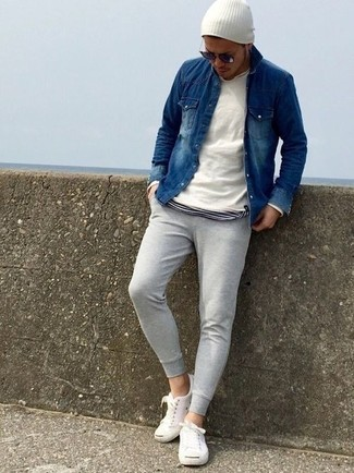 How to wear: white crew-neck sweater, navy denim shirt, white and black horizontal striped crew-neck t-shirt, grey sweatpants