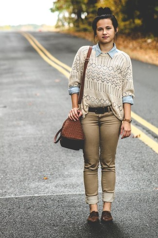 A cream crochet crew-neck sweater and brown slim jeans are perfect for both running errands and a night out. Dark brown leather oxfords will add elegance to an otherwise simple look.