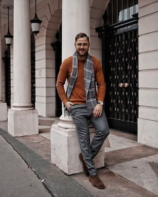 Tobacco Crew-neck Sweater Outfits For Men: This pairing of a tobacco crew-neck sweater and grey wool dress pants is a life saver when you need to look truly sharp and classy. Introduce brown suede chelsea boots to your getup and the whole ensemble will come together.