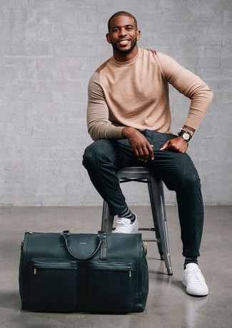 How to wear: tan crew-neck sweater, charcoal wool dress pants, white leather low top sneakers, black leather holdall