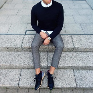 How to wear: navy crew-neck sweater, white dress shirt, grey wool chinos, navy leather low top sneakers