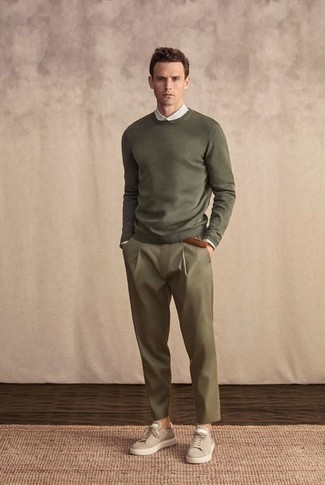 Men's Outfits 2021: An olive crew-neck sweater and olive chinos are a cool combination to add to your daily casual arsenal. Introduce a pair of beige suede low top sneakers to your outfit to immediately ramp up the appeal of this ensemble.