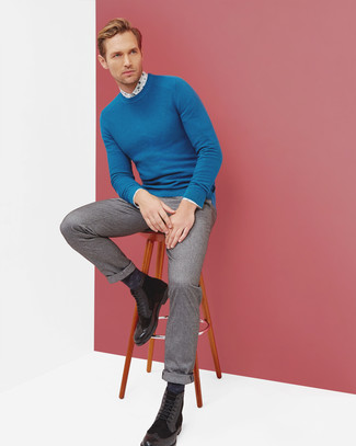 How to wear: blue crew-neck sweater, white floral dress shirt, grey wool dress pants, black leather brogue boots