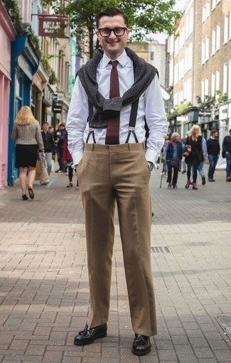 How to Wear a Burgundy Tie For Men: A charcoal crew-neck sweater and a burgundy tie are among the crucial elements of a solid wardrobe. Complete your outfit with a pair of black leather tassel loafers and the whole ensemble will come together.