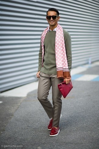Black Sunglasses Outfits For Men: This combination of an olive crew-neck sweater and black sunglasses is proof that a simple casual ensemble doesn't have to be boring. And if you need to effortlessly level up your outfit with footwear, add red leather boat shoes to the equation.