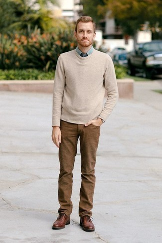 How to Wear a Navy Tie For Men: For an outfit that's absolutely Kingsman-worthy, marry a beige crew-neck sweater with a navy tie. Look at how nice this look is completed with brown leather brogues.