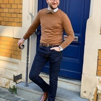 Bow-tie Outfits For Men: A tan crew-neck sweater and a bow-tie are must-have essentials if you're piecing together a casual wardrobe that matches up to the highest style standards. If you want to feel a bit more sophisticated now, add a pair of brown leather chelsea boots to the equation.