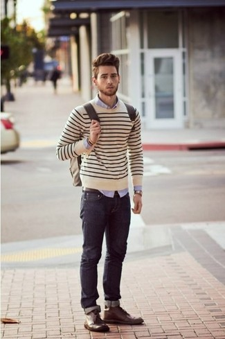How to wear: beige horizontal striped crew-neck sweater, light violet dress shirt, navy jeans, dark brown leather desert boots