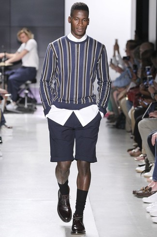 How to wear: navy vertical striped crew-neck sweater, white dress shirt, black shorts, dark brown leather derby shoes