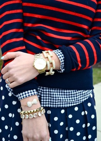 8c5cc545cf How to wear: red and navy horizontal striped crew-neck sweater, navy and