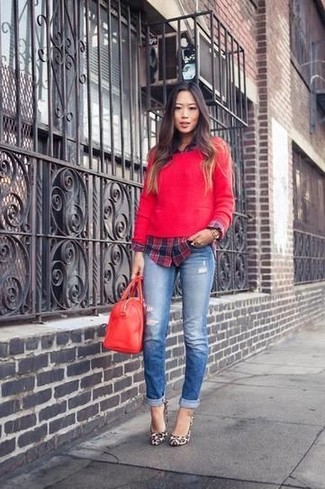 If you're a fan of classic pairings, then you'll like this combination of a red crew-neck jumper and blue ripped skinny jeans. For footwear go down the classic route with tan leopard leather pumps.
