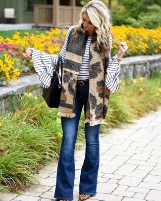 Pair a white and black horizontal striped crew-neck sweater with blue flare jeans to create a chic, glamorous look. Play down the casualness of your getup with tan leopard suede pumps. This getup is great for summer-to-fall weather.