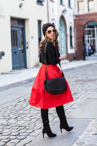 A black crew-neck pullover and a red full skirt are a great outfit formula to have in your arsenal. And if you want to instantly up the style ante of your look with one piece, enter black suede knee high boots into the equation. Loving how this outfit brings you into fall mode in seconds time.