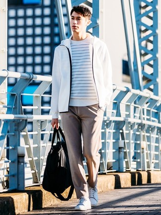 How to wear: white and blue horizontal striped crew-neck sweater, white hoodie, brown chinos, white leather low top sneakers