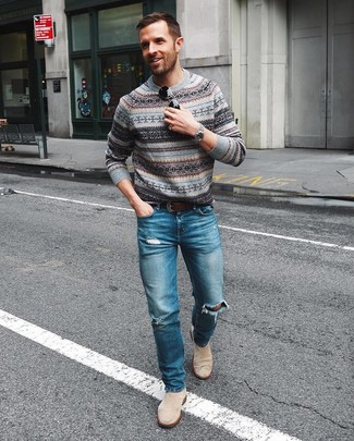 How to wear: grey fair isle crew-neck sweater, blue ripped jeans, beige suede chelsea boots, dark brown leather belt