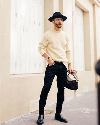 Dark Brown Leather Messenger Bag Outfits: This combination of a beige crew-neck sweater and a dark brown leather messenger bag is urban cool meets effortless comfort. Kick up this look by finishing off with a pair of black leather chelsea boots.