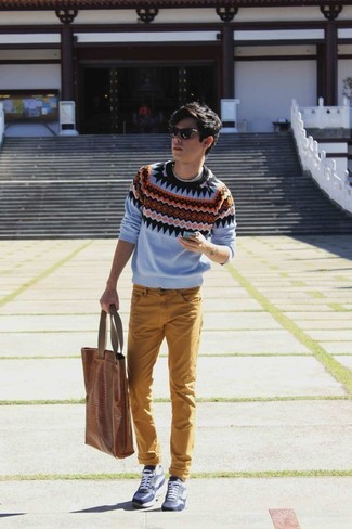 How to wear: light blue fair isle crew-neck sweater, mustard jeans, navy leather low top sneakers, brown leather tote bag