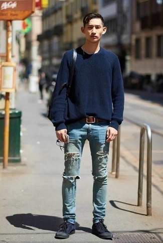 How to Wear a Black Leather Backpack For Men: A navy crew-neck sweater and a black leather backpack are a great combo to add to your day-to-day styling arsenal. Feeling brave? Shake up your ensemble by slipping into navy canvas low top sneakers.