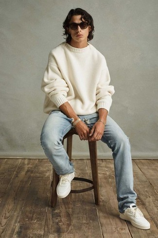 Light Blue Ripped Jeans Outfits For Men: A white crew-neck sweater and light blue ripped jeans are a cool combination to take you throughout the day and into the night. Kick up the classiness of your ensemble a bit by sporting a pair of white canvas low top sneakers.