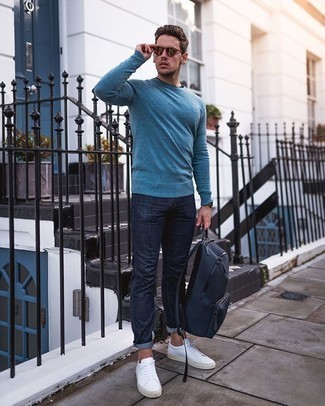 Men's Outfits 2020: Why not team a blue crew-neck sweater with navy jeans? Both of these pieces are very functional and look awesome when combined together. If you're wondering how to finish, grab a pair of white canvas low top sneakers.