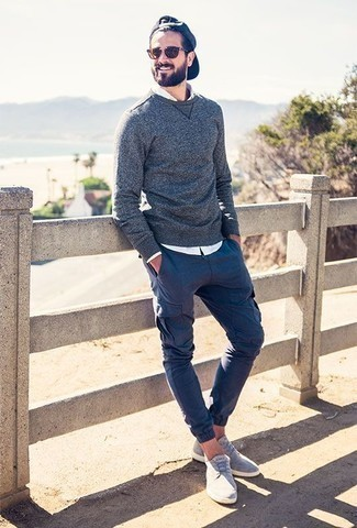 How to Wear Navy Cargo Pants: Wear a navy crew-neck sweater and navy cargo pants to create an extra stylish and current casual outfit. Our favorite of a great number of ways to round off this getup is with a pair of light blue suede low top sneakers.