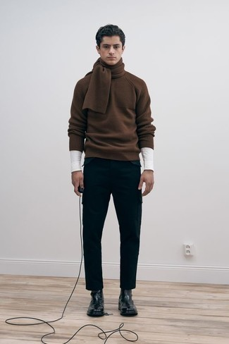 Brown Crew-neck Sweater Outfits For Men: A brown crew-neck sweater and black cargo pants are a savvy getup worth incorporating into your off-duty styling collection. Wondering how to finish your ensemble? Round off with a pair of black leather chelsea boots to lift it up.