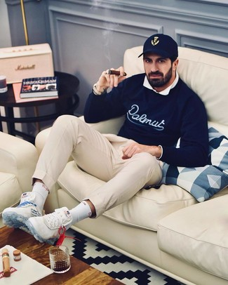 How to wear: navy print crew-neck sweater, white long sleeve shirt, beige chinos, white athletic shoes