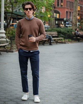 Men's Looks & Outfits: What To Wear In Spring: This relaxed casual pairing of a brown crew-neck sweater and navy chinos is a never-failing option when you need to look sharp in a flash. To inject a playful feel into this getup, complete this ensemble with white leather low top sneakers. And if you're on the lookout for a cool winter-to-spring getup, this one fits the task well.