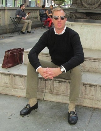 Black Crew-neck Sweater Outfits For Men: For an ensemble that delivers practicality and dapperness, wear a black crew-neck sweater with olive chinos. Wondering how to complement your look? Finish with black leather loafers to amp it up a notch.