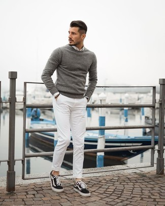 White Long Sleeve Shirt Outfits For Men: For an on-trend getup without the need to sacrifice on functionality, we turn to this pairing of a white long sleeve shirt and white chinos. A pair of dark brown canvas low top sneakers instantly dials up the fashion factor of your ensemble.