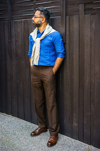 Brown Chinos Smart Casual Outfits: Why not make a white crew-neck sweater and brown chinos your outfit choice? Both items are totally functional and will look nice when worn together. For a dressier aesthetic, complete your outfit with a pair of dark brown leather derby shoes.