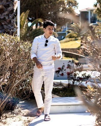 Men's Outfits 2021: A grey crew-neck sweater and white vertical striped chinos are essential menswear pieces, without which no wardrobe would be complete.