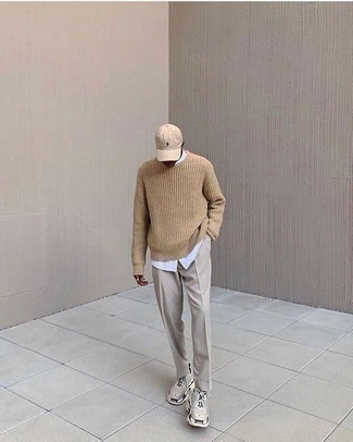 Beige Athletic Shoes Outfits For Men: You're looking at the irrefutable proof that a tan crew-neck sweater and beige dress pants look awesome when worn together in a classy getup for today's man. Send this getup a less formal path by finishing off with beige athletic shoes.