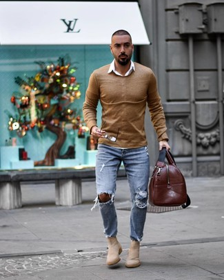 How to Wear a Brown Leather Holdall In Warm Weather For Men: This combination of a tan crew-neck sweater and a brown leather holdall is on the casual side yet it's also sharp and really dapper. To give your overall ensemble a smarter finish, why not add beige suede chelsea boots to the mix?