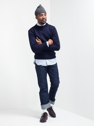Men's Looks & Outfits: What To Wear In Spring: Pair a navy crew-neck sweater with navy jeans to achieve a really sharp and modern-looking casual outfit. Complete your outfit with dark brown leather derby shoes to completely change up the look. So as you can see here, it's a cool, not to mention spring-appropriate, combo to keep in your seasonal rotation.