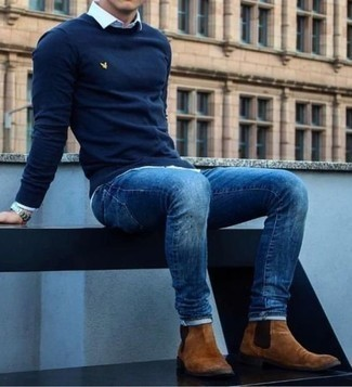 How to Wear a Navy Crew-neck Sweater For Men: A navy crew-neck sweater and blue jeans matched together are a sartorial dream for those dressers who appreciate casually stylish ensembles. Brown suede chelsea boots are guaranteed to give a dose of polish to this look.
