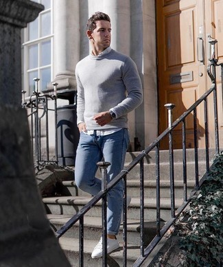 Light Blue Jeans with White Shirt Outfits For Men: This laid-back and cool ensemble is so simple: a white shirt and light blue jeans. A pair of white and black canvas low top sneakers instantly steps up the wow factor of your ensemble.