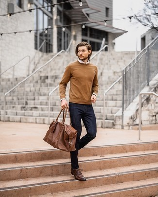Tobacco Crew-neck Sweater Outfits For Men: This laid-back and cool outfit is so simple: a tobacco crew-neck sweater and navy jeans. Play down the casualness of your getup by slipping into brown leather brogues.