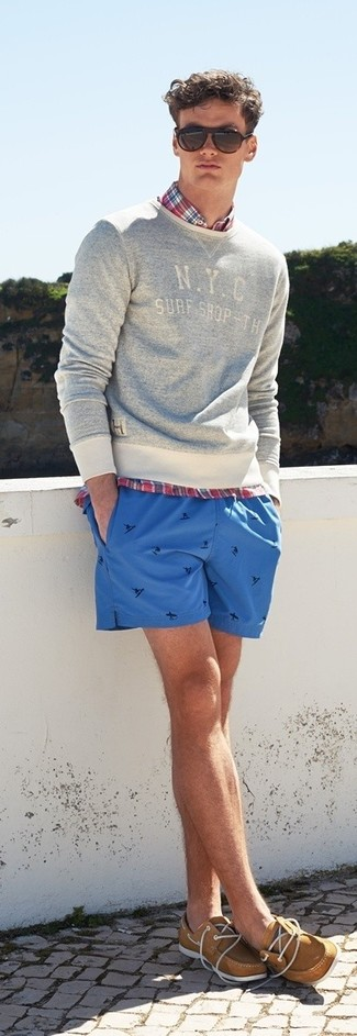 How to wear: grey print crew-neck sweater, red plaid long sleeve shirt, blue print shorts, tan leather boat shoes