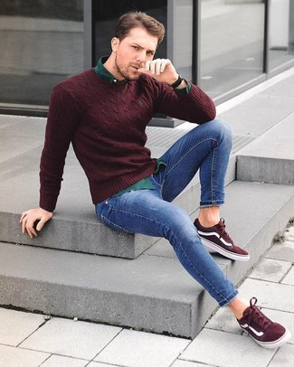 How to wear: burgundy crew-neck sweater, dark green long sleeve shirt, blue skinny jeans, burgundy suede low top sneakers